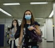 A woman wearing a face mask walks through a subway station in Seoul today.- AFP