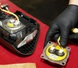A mechanic holding a Takata airbag inflator  after it has been removed from a steering wheel. - Reuters