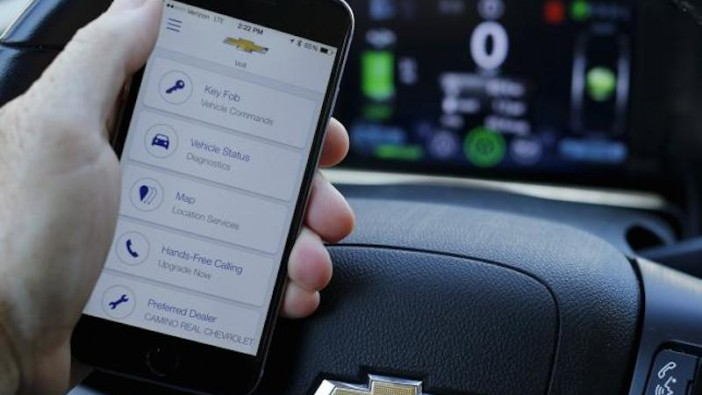A mobile phone displays the OnStar app inside a Chevrolet Volt vehicle. - Reuters