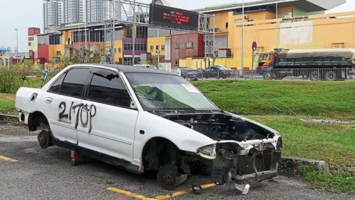 What is left of a car after parts were stolen at PJS 10.