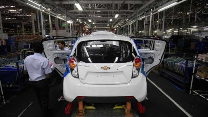 GM employees working on a Chevrolet Beat car on an assembly line at a plant near Mumbai in this 2012 file photo.- Reuters