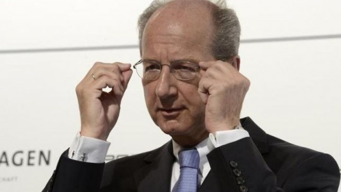 Poetsch adjusting his glasses during a news conference in Wolfsburg in July 5, 2012. - Reuters
