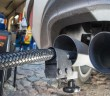 A measuring hose for emissions inspections in diesel engines sticks in the exhaust tube of a Volkswagen Golf 2,0 TDI diesel car at a garage in Frankfurt an der Oder, eastern Germany, on Oct 1. - AFP