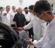 Idris (in black shirt) observing DRB-Hicom university students working on the car's bodywork. - Bernama